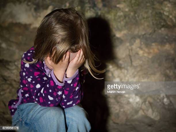 little girl sitting on floor crying - obscured face stock photos and pictures