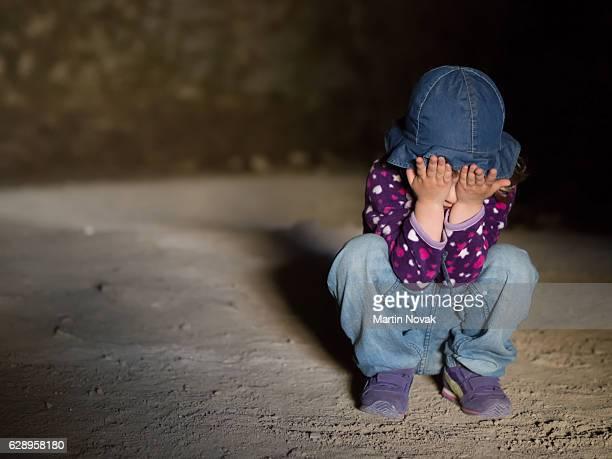 Little girl sitting on floor crying