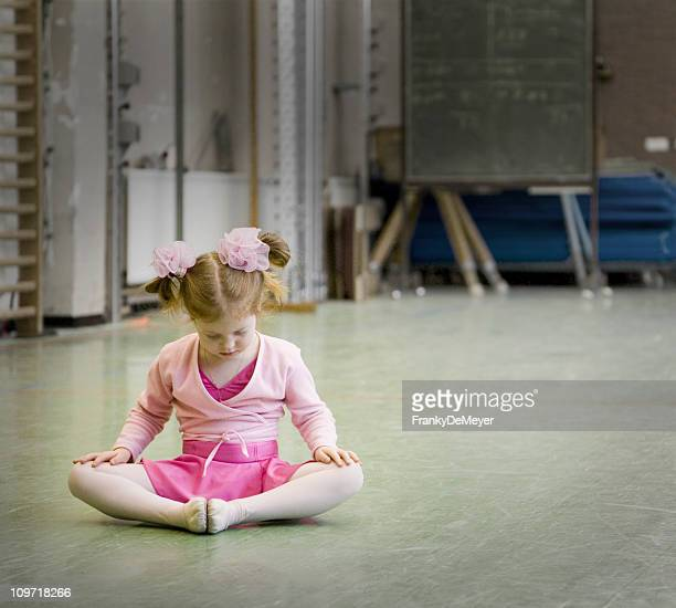 Little Girl Sitting on Floor During Ballet Class