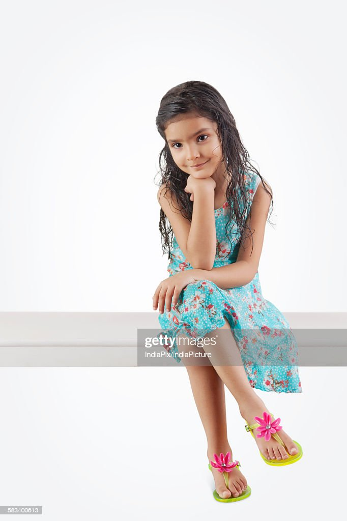 Little girl sitting : Stock Photo