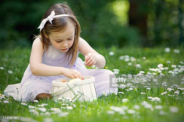 Little girl sitting with her Easter basket