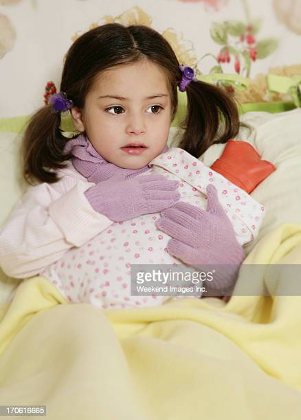 little girl sitting with Hot Water Bottle