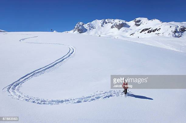Little girl skiing on mountain