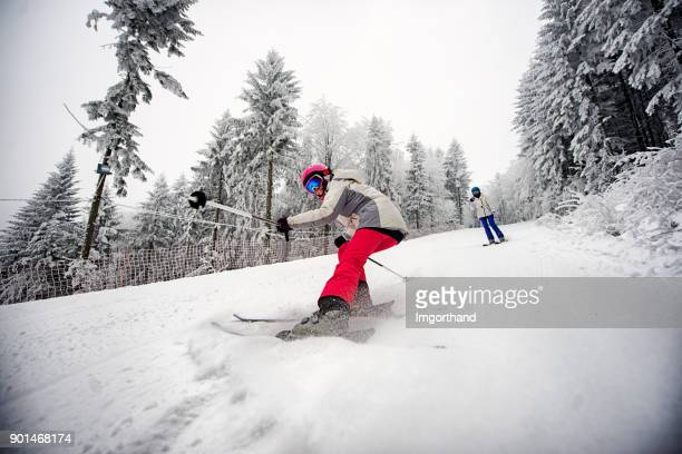Little girl skiing with mother