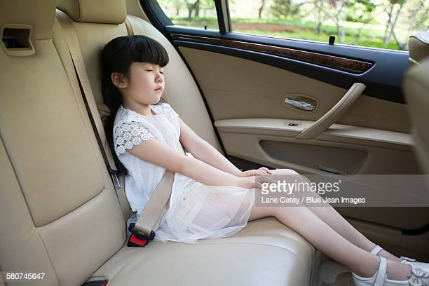 Little girl sleeping in car back seat