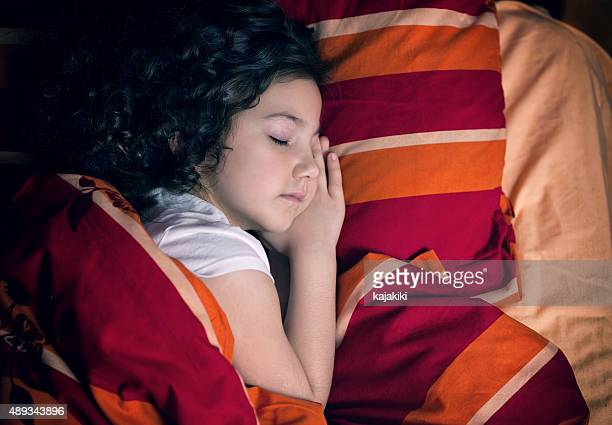 Little Girl Sleeping in Her Room