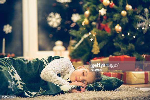 little girl sleeping under the christmas tree - night before stock photos and pictures