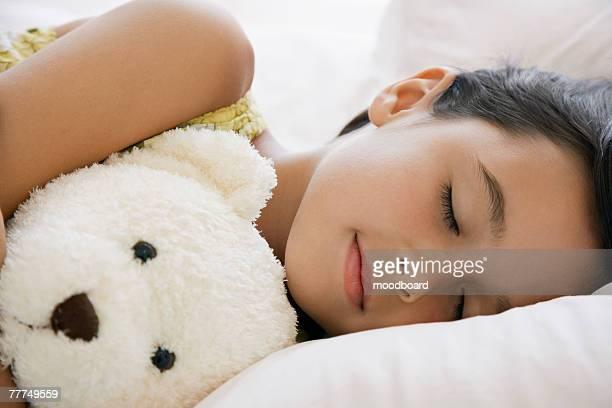 Little Girl Sleeping with a Teddy Bear