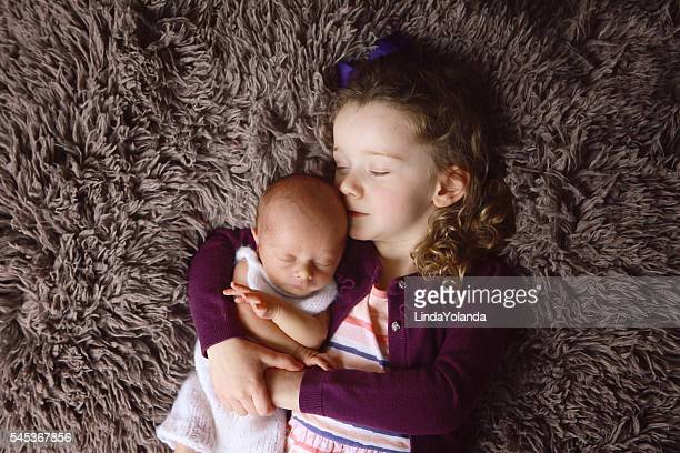 Little Girl Sleeping with her Newborn Brother