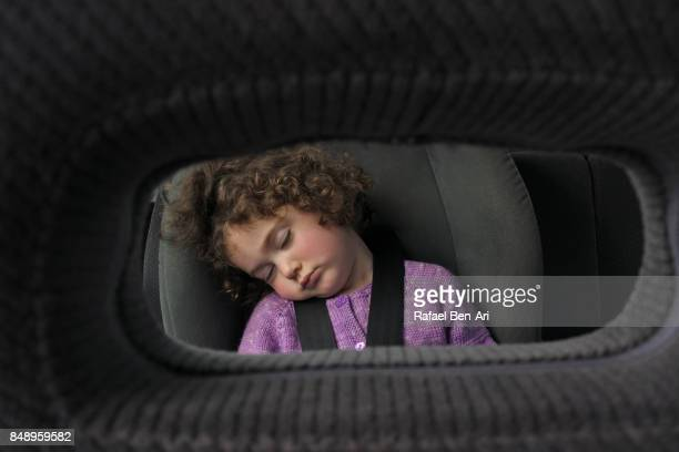 Little girl sleeps in a car sit during a drive