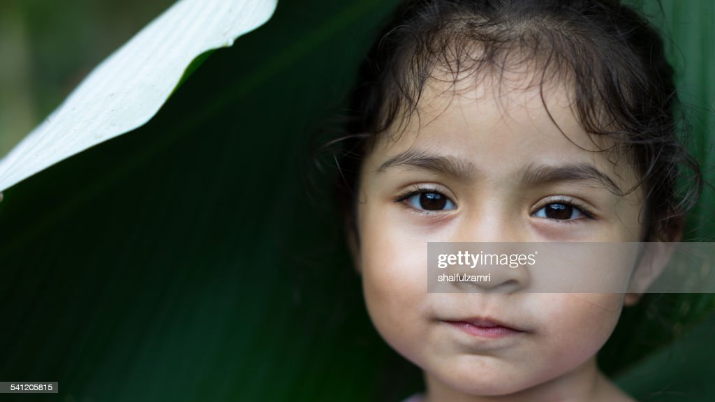 little girl smile looking to you : Stock Photo