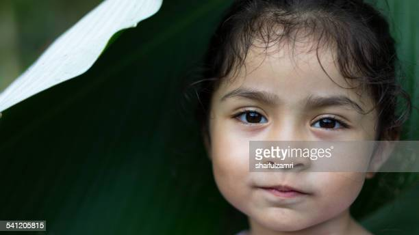 little girl smile looking to you - shaifulzamri stock pictures, royalty-free photos & images