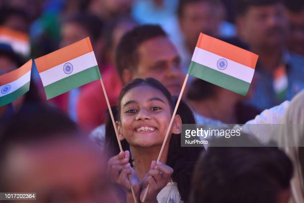 A Little girl smiles as holding the tricolor India Flag during 72nd Independence Day celebrated in Kathmandu Nepal on Wednesday August 15 2018