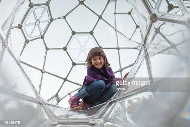 Little girl smiling and enjoying jungle gym