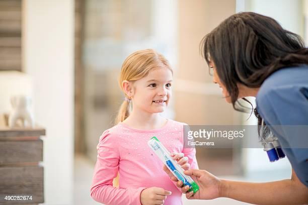 Little Girl Smiling at a Dental Assistant