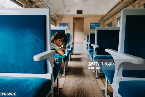 Little girl smiling at camera in train