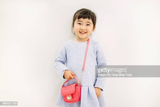Little girl smiling joyfully at camera