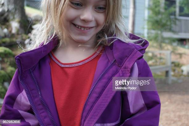 little girl smiling outdoors - red jacket stock pictures, royalty-free photos & images