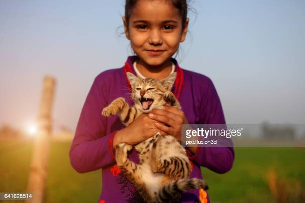 Little girl smiling portrait with her cat