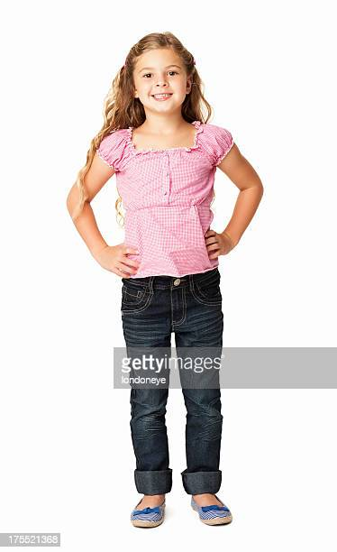 little girl smiling with hands on hip - isolated - handen op de heupen stockfoto's en -beelden
