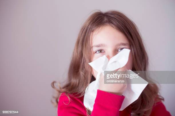 little girl sneezing - pathogen stock photos and pictures