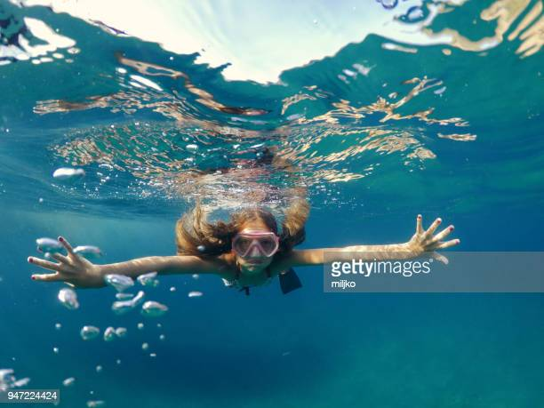 little girl snorkeling and having a fun in the sea - thasos stock photos and pictures