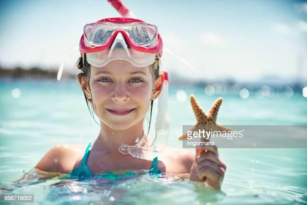 Little girl snorkeling in beautiful sea