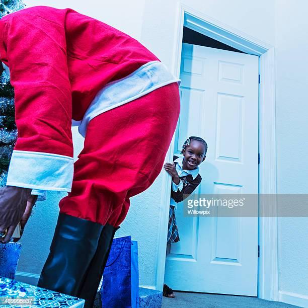 Little Girl Spying On Santa Claus