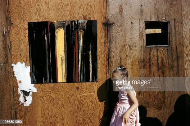 A little girl standing by an abstract painting at the Washington Square Outdoor Art Exhibit New York City1962