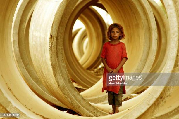 Little Girl Standing In Sewerage Pipes