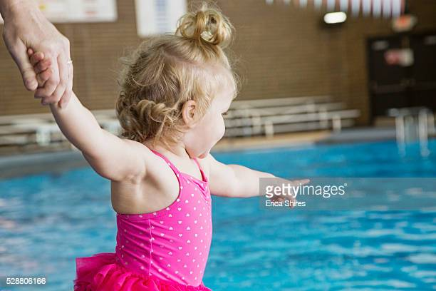 little girl (12-23 months) standing near swimming pool - 12 23 months stock pictures, royalty-free photos & images