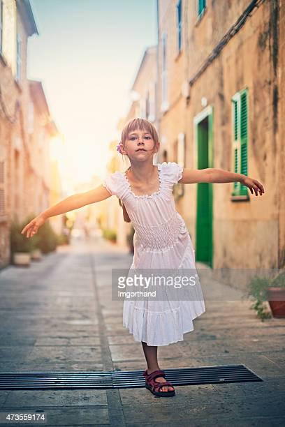 Little girl standing on one leg