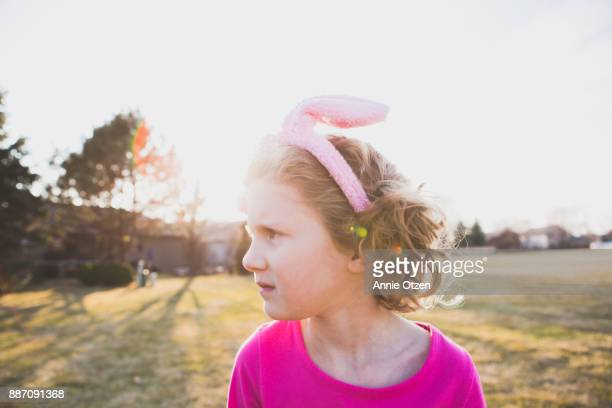 Little Girl Stands Outside Wearing Bunny Years