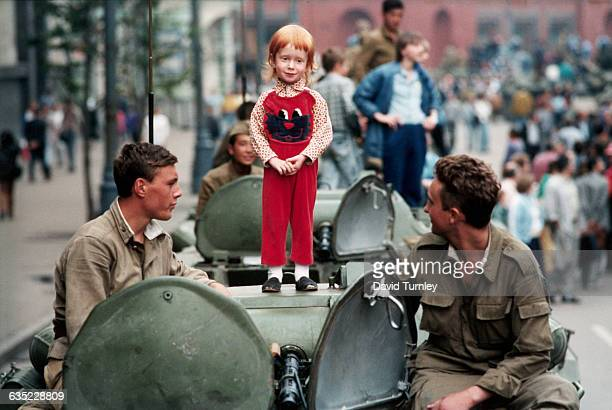 Little girl stands placidly atop a Soviet tank in the barricades at Red Square during the Communist hard liners' coup attempt in August 1991.