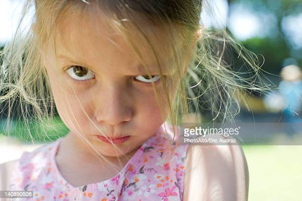 little girl staring at camera with lips pursed - sulking stock photos and pictures