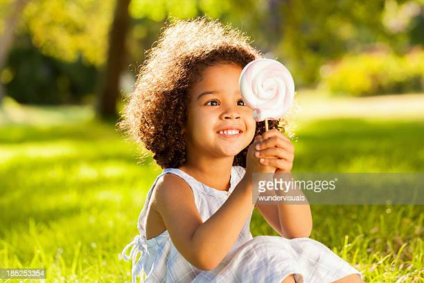 Little Girl Staring At Lollypop