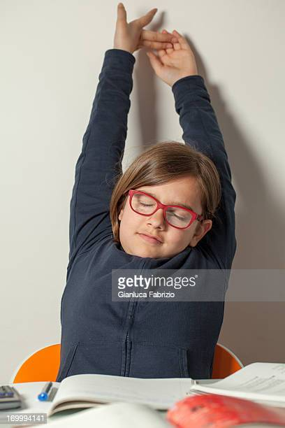 little girl stretching after finishing her homework - the end stock pictures, royalty-free photos & images