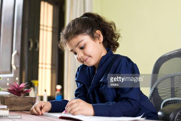 little girl studying at home - children only stock pictures, royalty-free photos & images