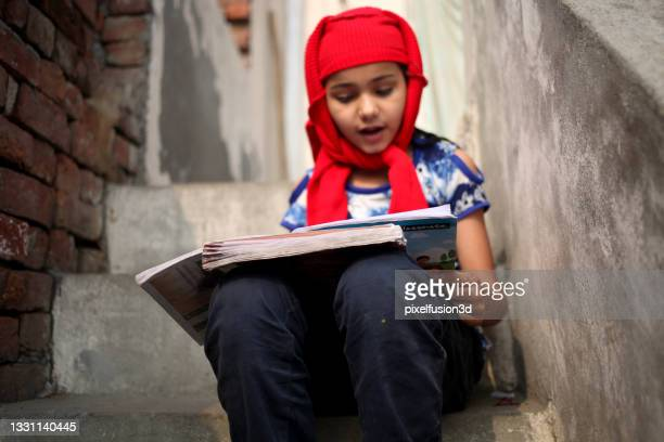little girl studying portrait at home - headwear stock pictures, royalty-free photos & images