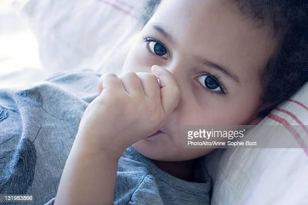 Little girl sucking thumb