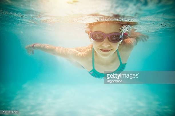 Little girl swimming underwater
