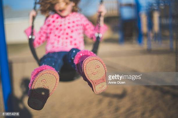 little girl swinging - school girl shoes stock pictures, royalty-free photos & images