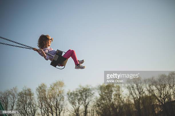little girl swinging - swinging stock pictures, royalty-free photos & images