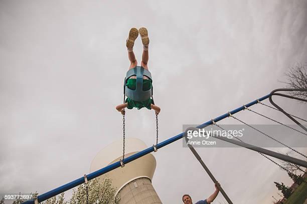 Little Girl Swinging Up High