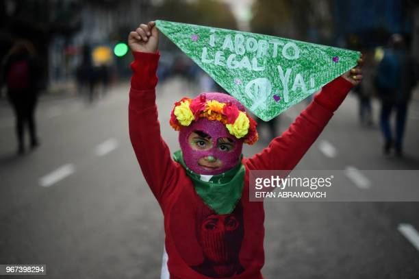 TOPSHOT A little girl takes part in a march called by the movement 'Ni una menos' against violence against women and in demand of the right to a safe...