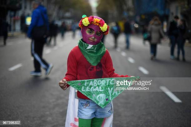 A little girl takes part in a march called by the movement 'Ni una menos' against violence against women and in demand of the right to a safe free...
