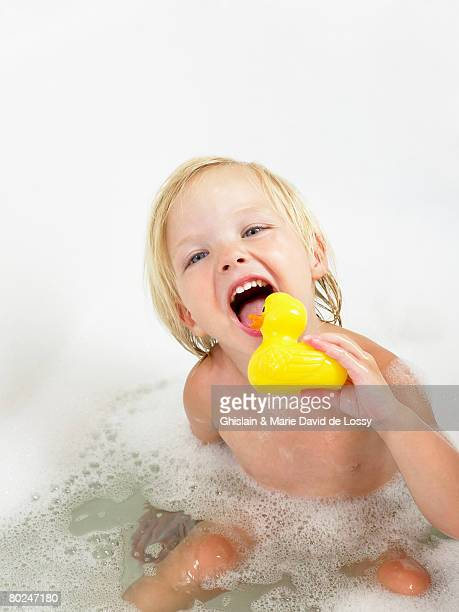 Little girl taking a bath yellow duck.