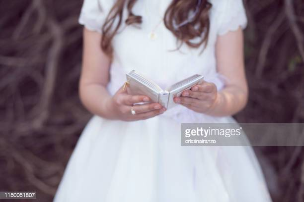 little girl taking communion - communion stock pictures, royalty-free photos & images