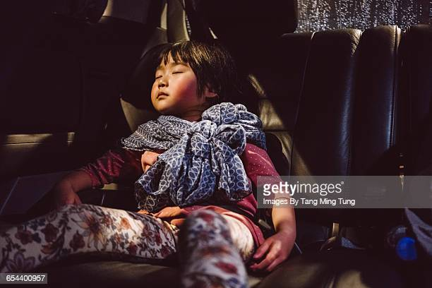 Little girl taking nap in car at night