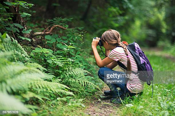 little girl taking photos in the forest - pre adolescent child stock pictures, royalty-free photos & images